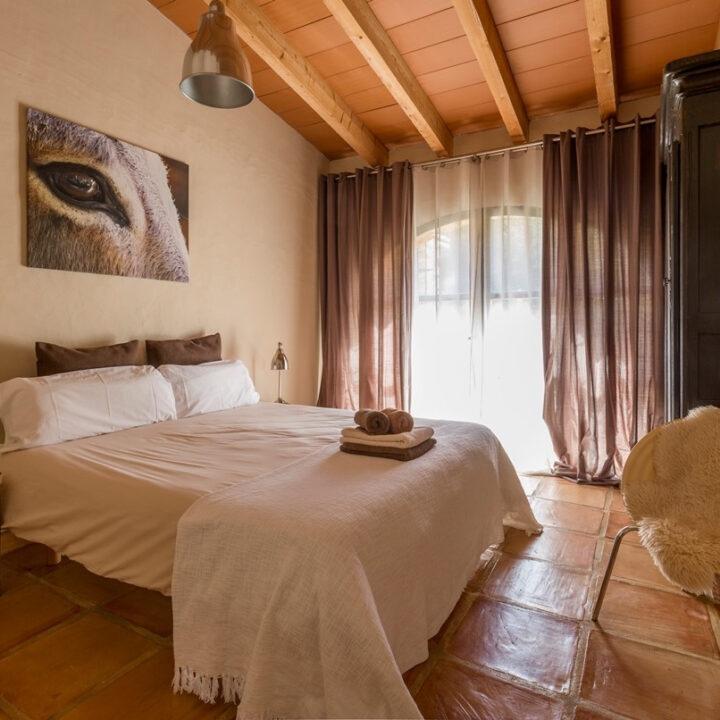 Slaapkamer in het vakantiehuis in Spanje