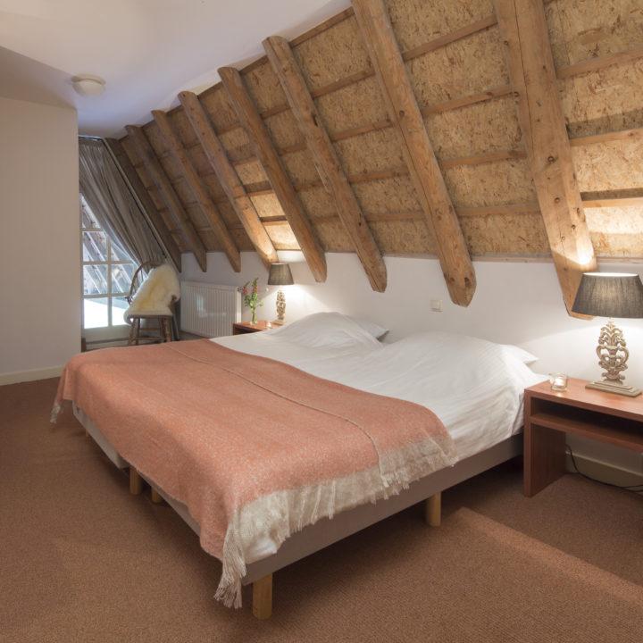Ruime slaapkamer in de accommodatie in Brabant