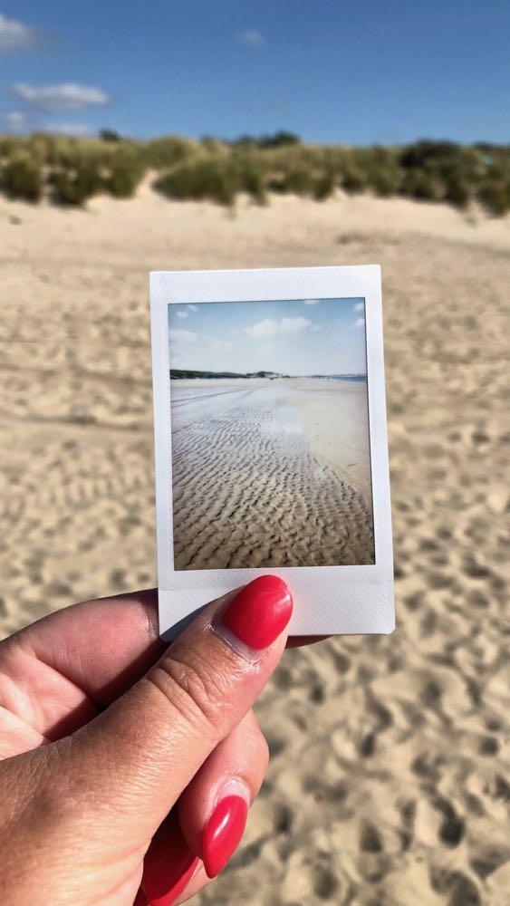 Een polaroid foto voor de duinen