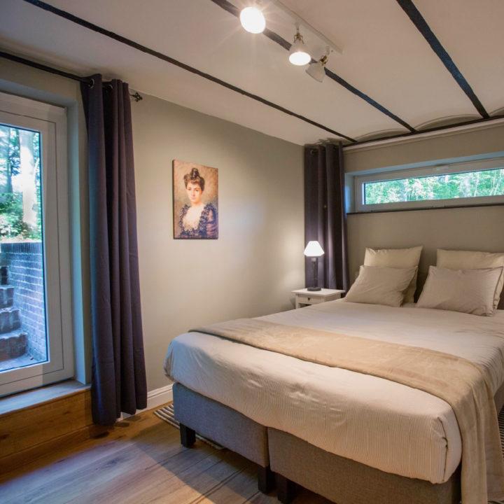 Een van de slaapkamers van het Atelier van Antonine