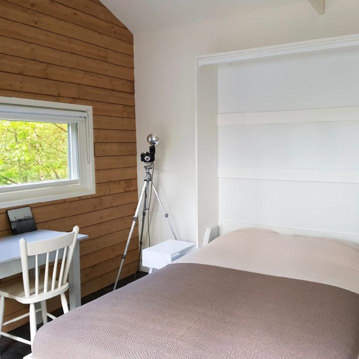 Slaapkamer in het vakantiehuis van FINT Lauwersoog