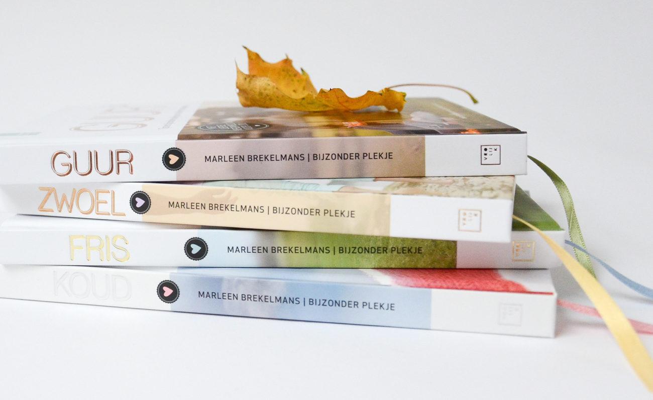 Close up van vier boeken Guur, Zwoel, Fris en Koud