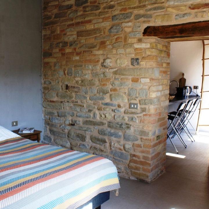 Slaapkamer van een appartement in de agriturismo
