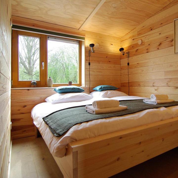 Een slaapkamer in een vakantielodge bij Amsterdam
