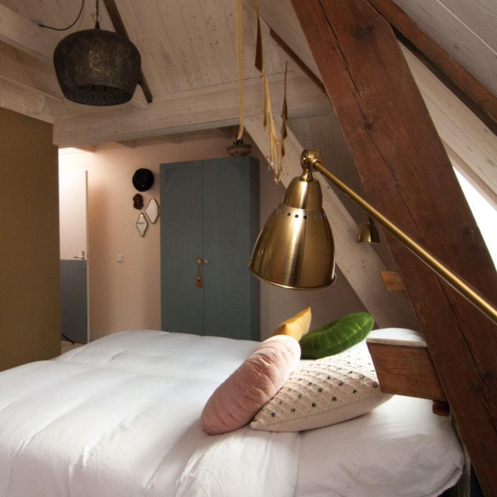Slaapkamer van Herberg in Den Ham