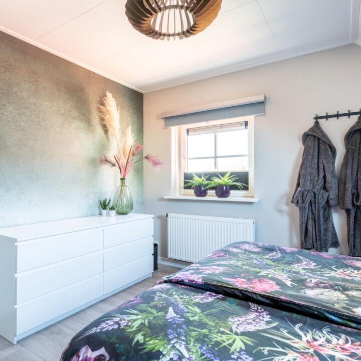 Slaapkamer in het vakantiehuis op Ameland
