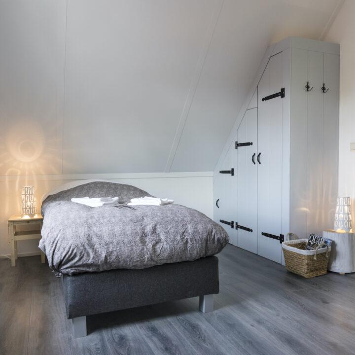 Slaapkamer van het vakantiehuis in Zeeland