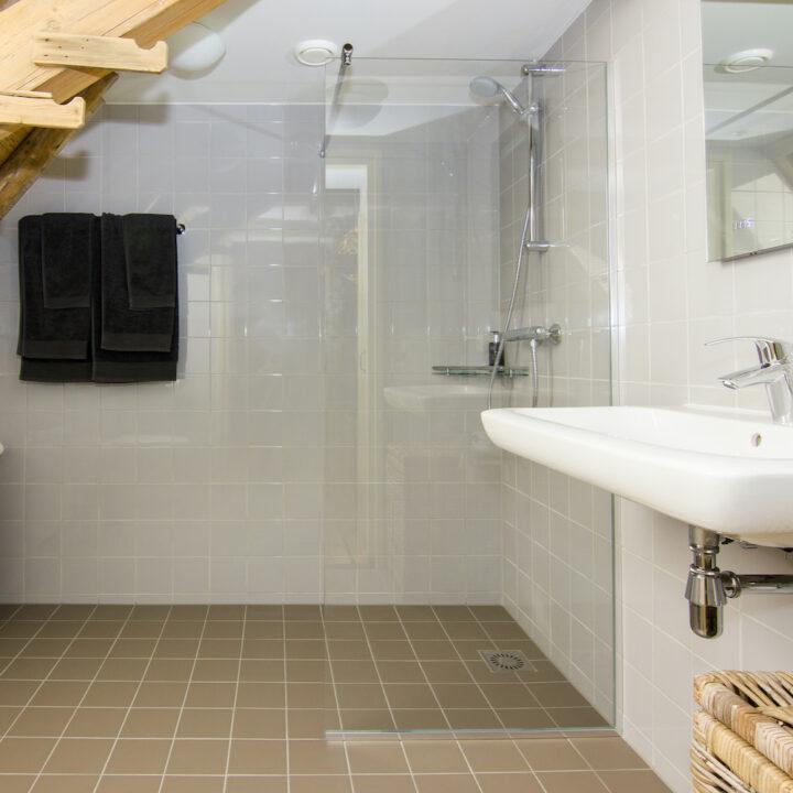 Badkamer bij een van de suites
