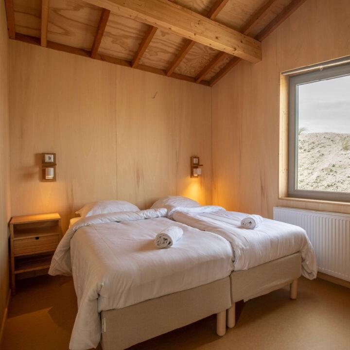 Slaapkamer in het duurzame vakantiehuis op Landal Marker Wadden