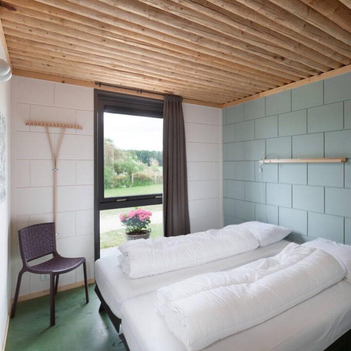 Slaapkamer in het vakantiehuis op de boerderij